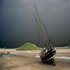 sailing vessel aground village